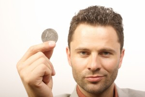 man with one dollar coin
